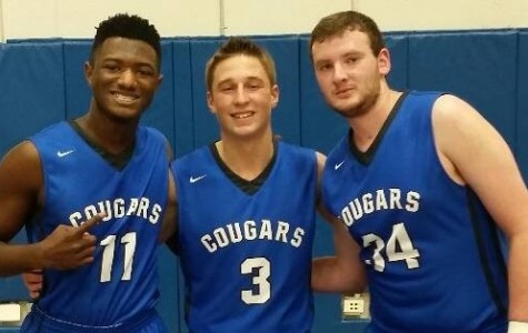 Jay Halloway (12), Tanner Tolari (12), and Jake Helfand (12) all pose for a picture during practice.
