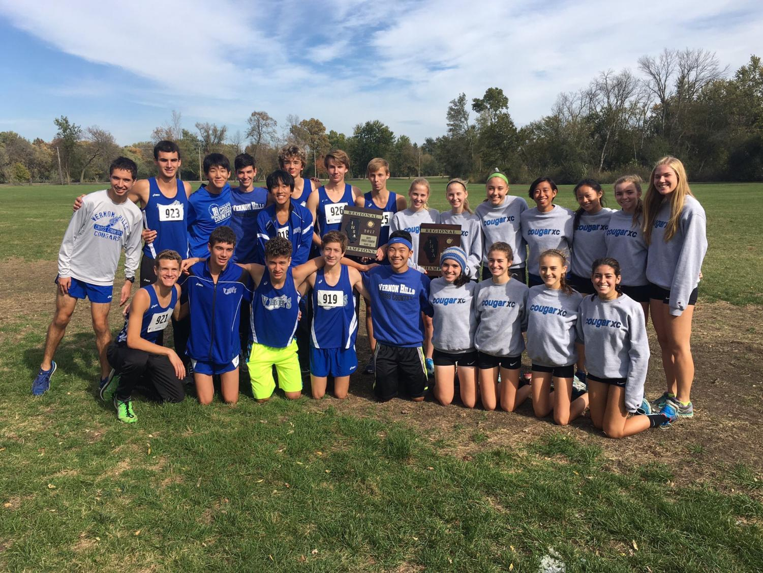 The girls and boys teams pose with their respective first place trophies at the Regional Championships Oct.21