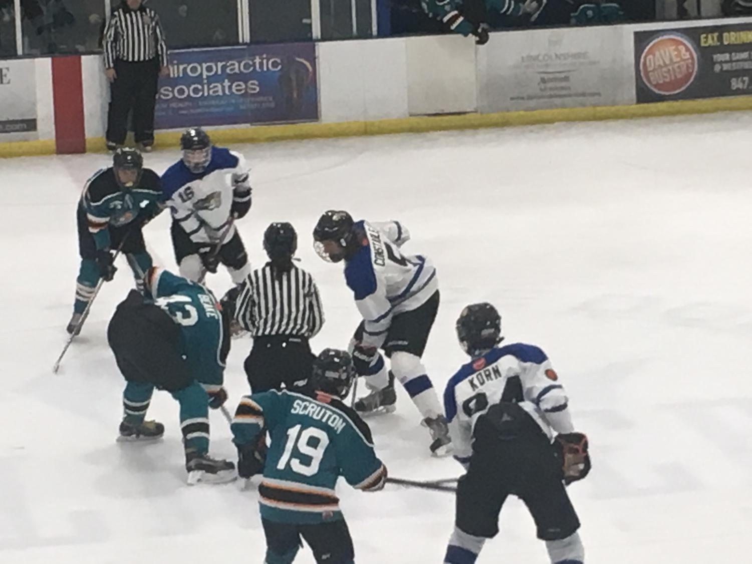 IceCats lineup for a faceoff during a January 27th game vs. the Lakers