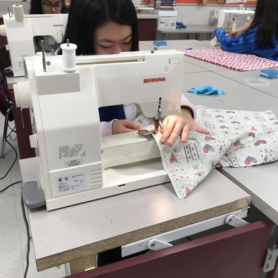 Paige Lee (10) starts to sew a dress for Dress a Girl Around The World.