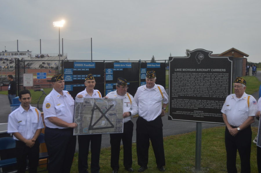 Six+veterans+pose+next+to+the+new+historical+marker+outside+of+Rust-Oleum+Field.