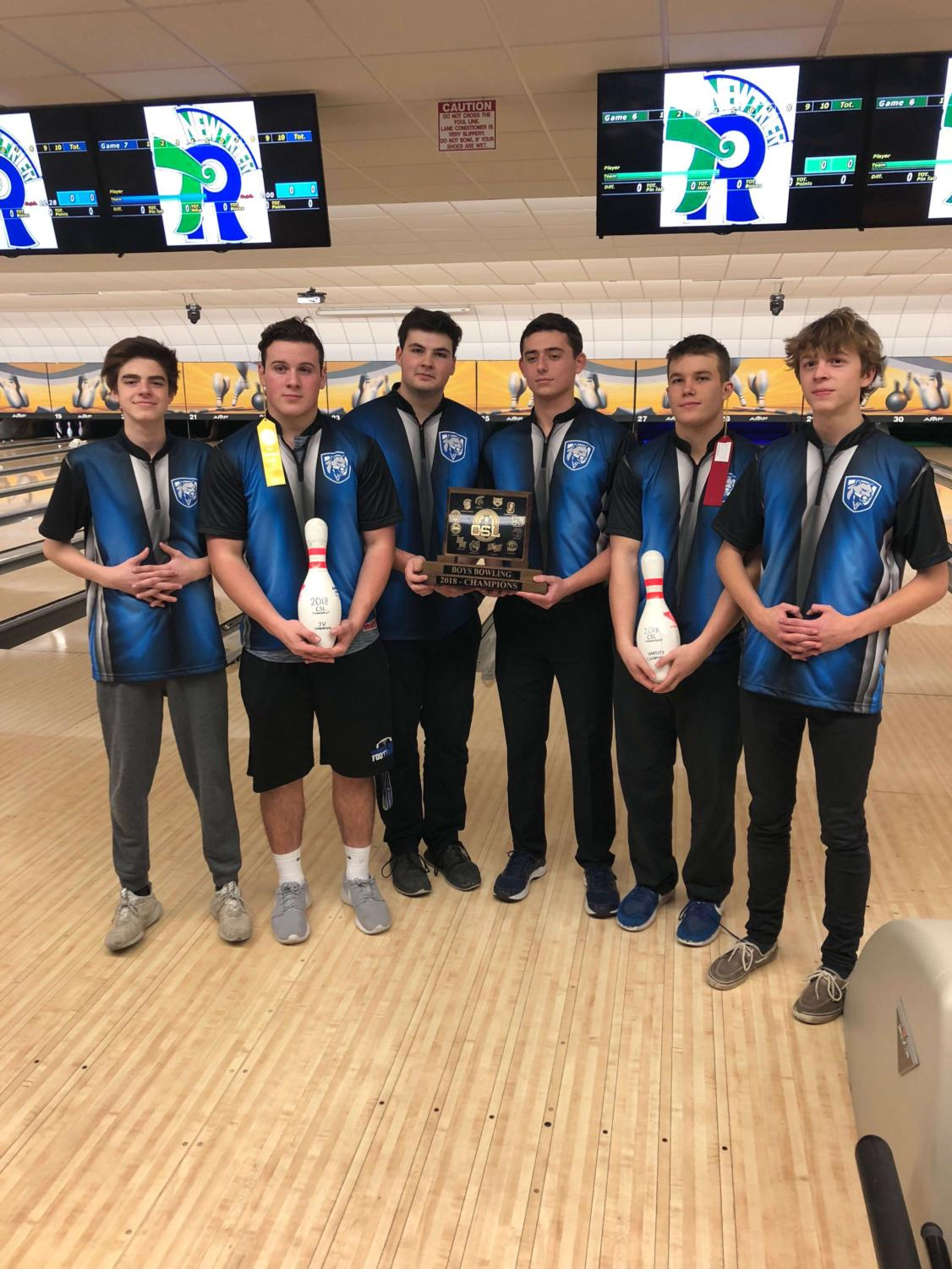 Seniors Ben Kushnir, Derek Jarrell, Nick McNamara, Logan Coty, Jake Morris, and Cooper Guillaume are holding their first place conference trophy.