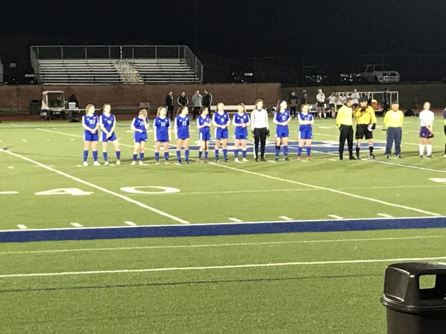 Starters+for+the+girls+soccer+team+line+up+for+the+National+Anthem+prior+to+their+game+against+Wauconda+High+School.