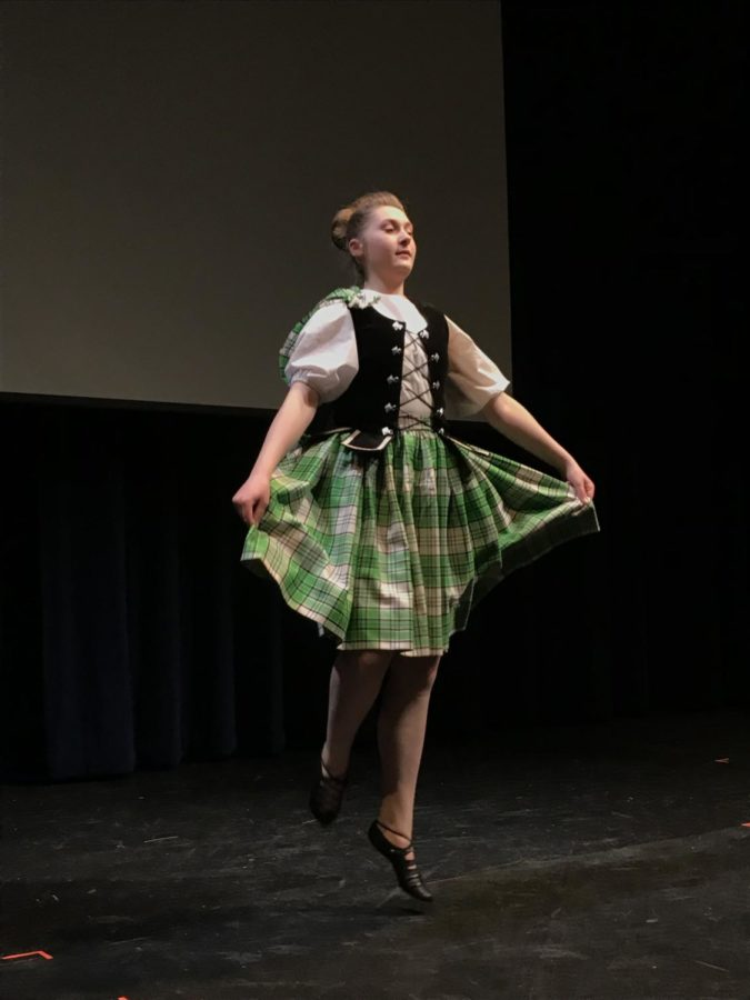 Girl in green dress as part of the Scottish dance performance at vhhs.