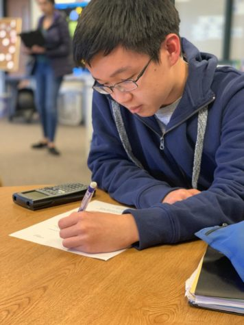 This is a photo of Jeffrey Zhang practicing math.