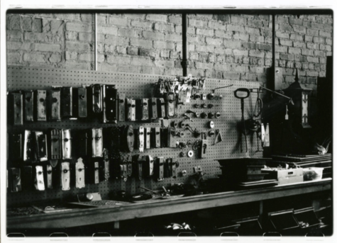 A black and white photo of a toolshed