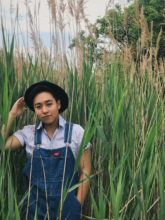 Picture of Wesley Kim standing in a field with an iconic outfit.