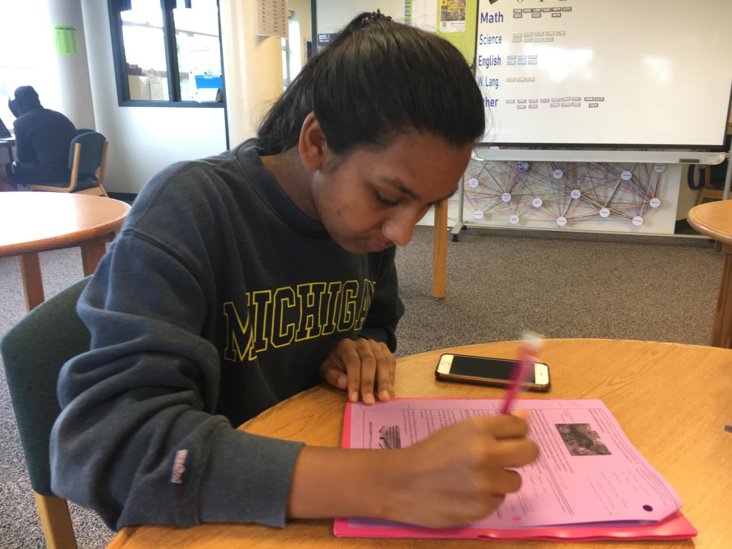 Mira Singh (11) diligently works on homework for a social studies class.