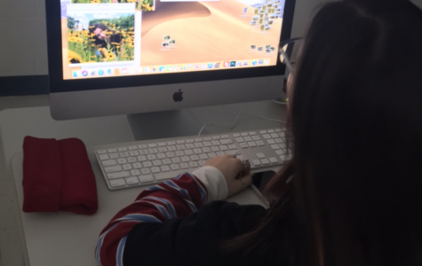 A student using a computer in class