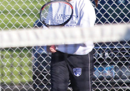 Picture of Claudia Bilkey (11) on the tennis court.