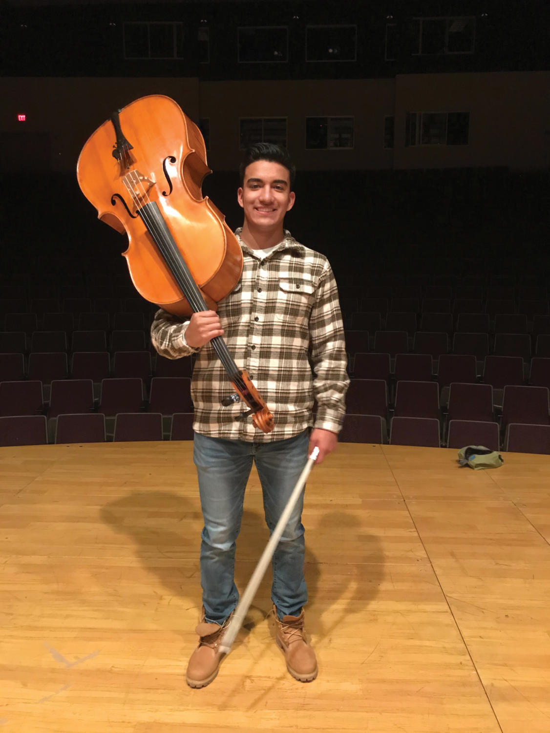 Diego Corrales (12) holds his cello.