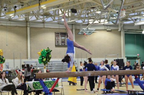 Becca Tran performs a backhandspring during a competion.