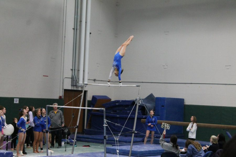 Dylan+Sides+%2811%29+competes+in+the+regional+meet+on+the+uneven+bars.