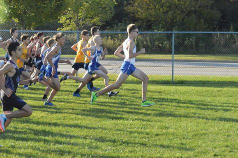 Image showing David Rzepa leading in first place at a meet.