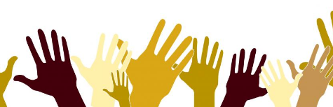 Image of hands with different skin tones raised in the air.