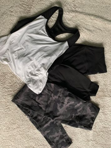 A photo of leggings and other workout clothes.