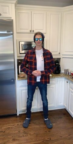 Zander poses in a flannel and jeans.