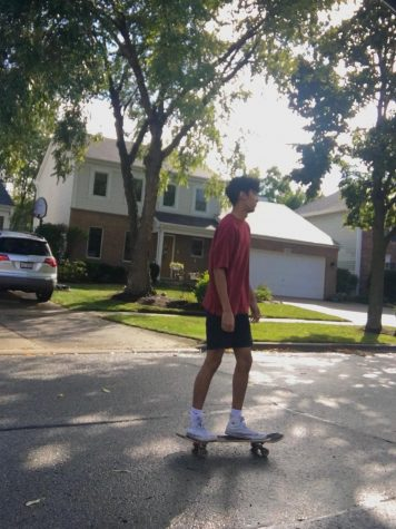 Sanjay Shrestha (12) skates outside after school to unwind.