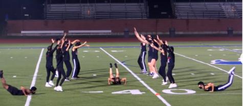 "Senior Lip Sync group ""Impostors"" performs their routine on the football field."