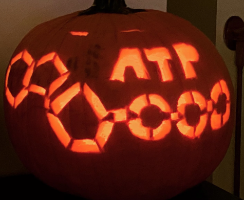 Pictured is a pumpkin with an ATP chemical carved onto it.
