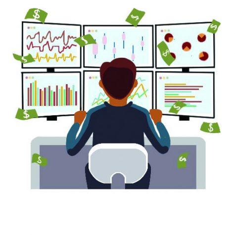 A young man sits at his computer and trades stocks.