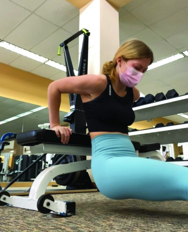 Mia Mihalic uses her triceps to push herself up and down in order to exercise her arms.