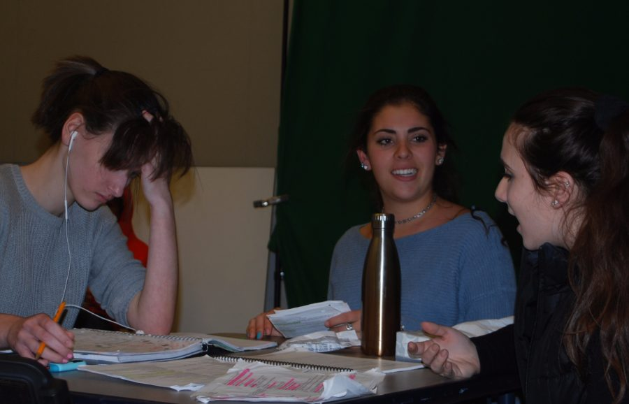 From left to right: Jackie Zurow(10), Sari Gluck (9), and Erica Floss-Becker (10) rehearse for their play,  Frosh In The Pit.