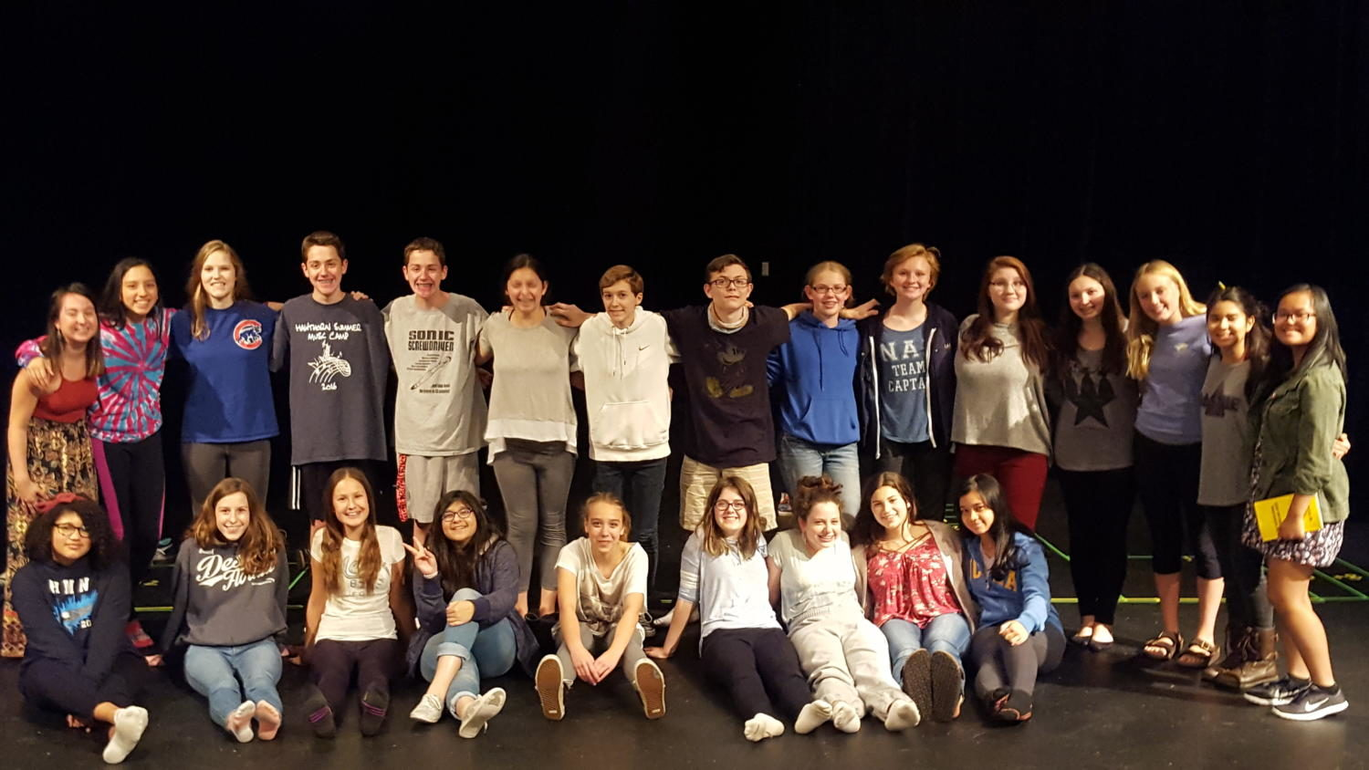 Group photo of cast and director