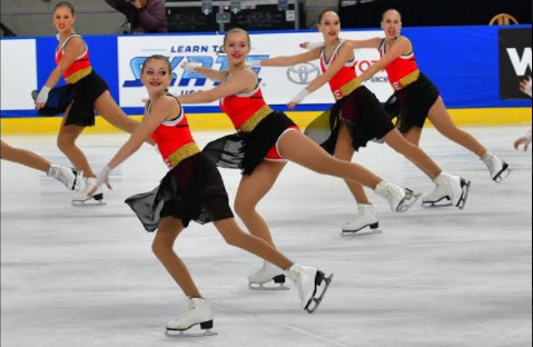 Lauren Costin (middle) competes with her team, Teams Elite. Teams Elite is a synchronized skating team out of Northbrook