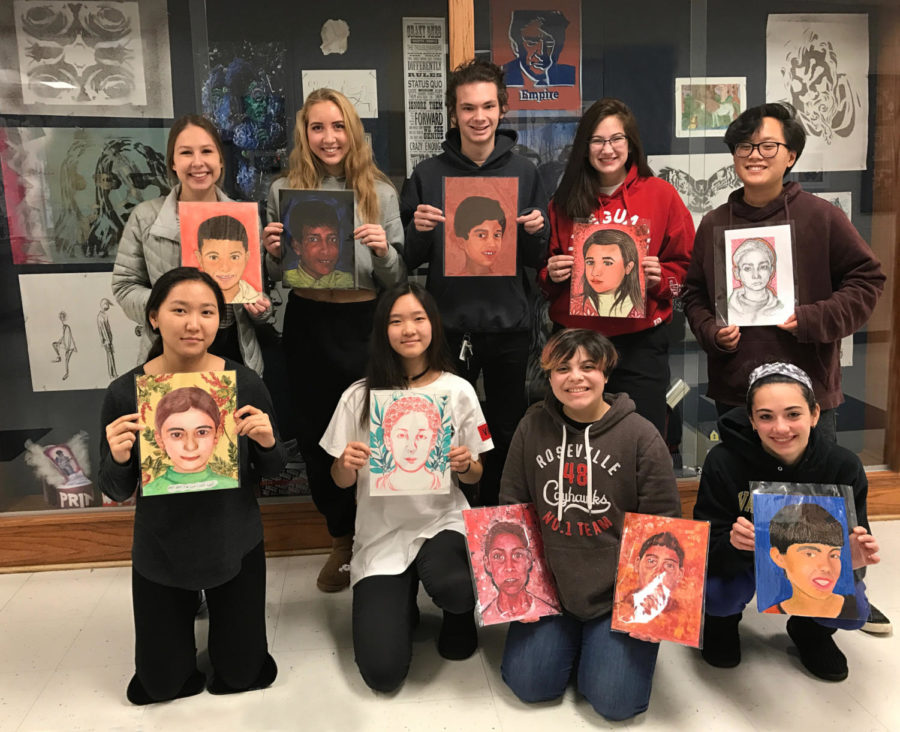 Nine art students pose in two rows with portraits of children.