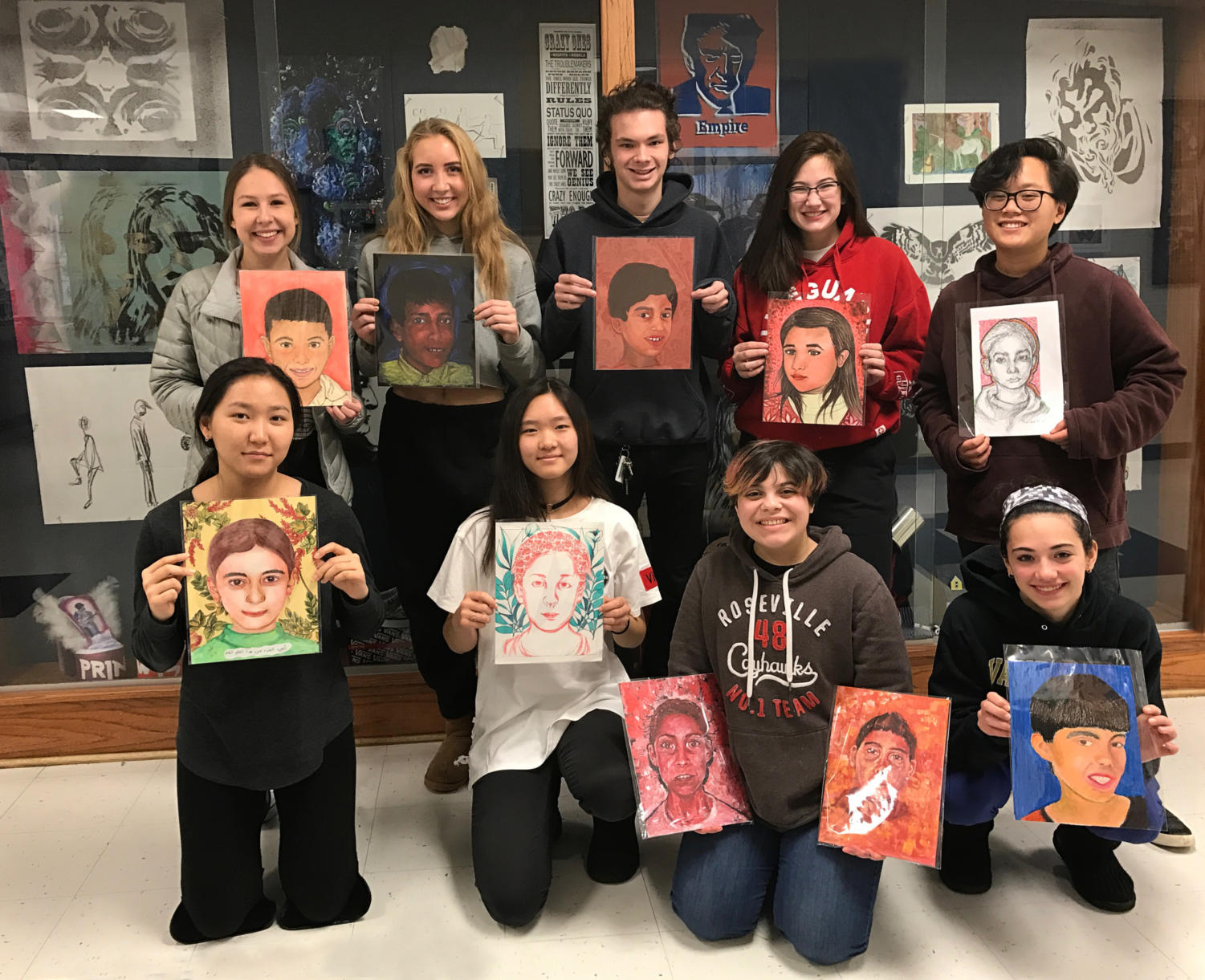 AP art students pose with their finished portraits before they are sent to Syrian refugees in Jordan.