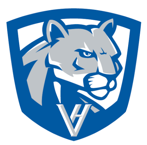 This photo features the new Vernon Hills High School logo, which features a cougar head, the letters VH, and a shield surrounding those elements.