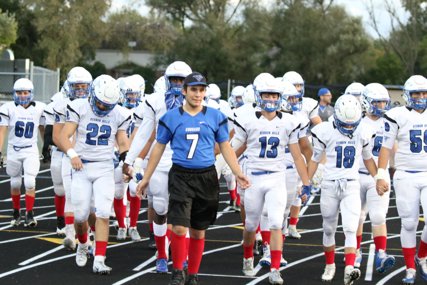 The VHHS Varsity Football Team supported Bellecomo by wearing red socks at Highland Park High School on Sept. 21.