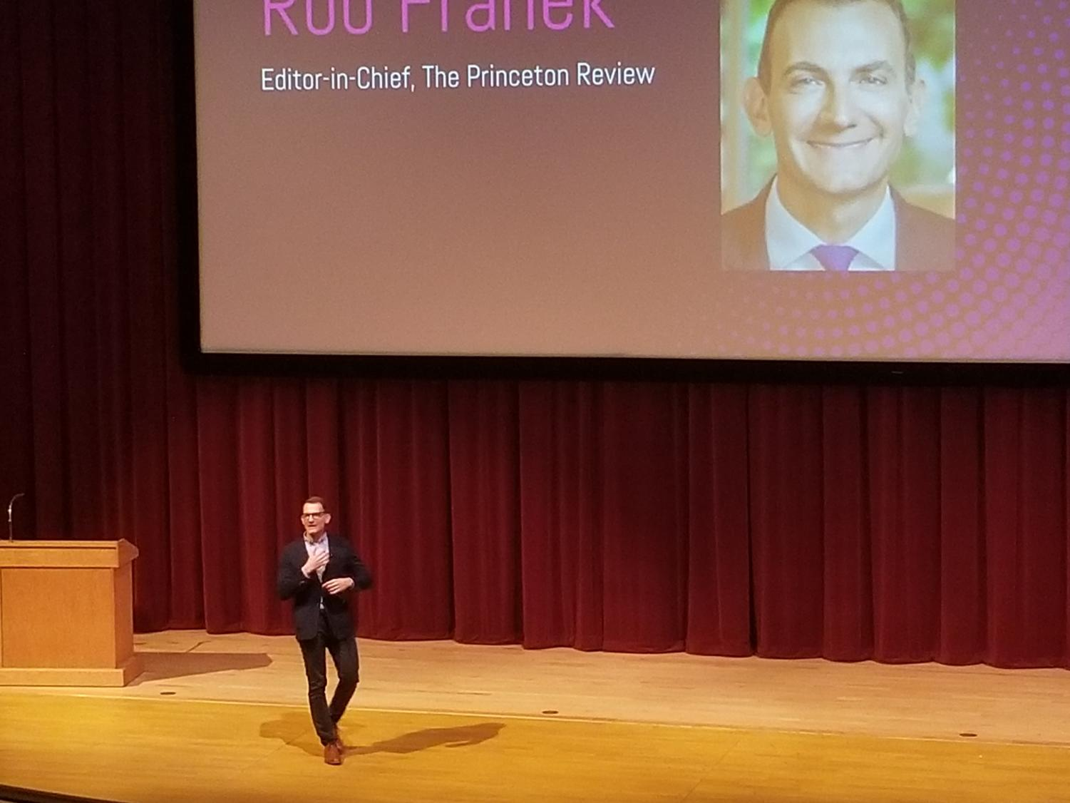 Robert Franek walks onto stage to begin his presentation on behalf of the Princeton Review.