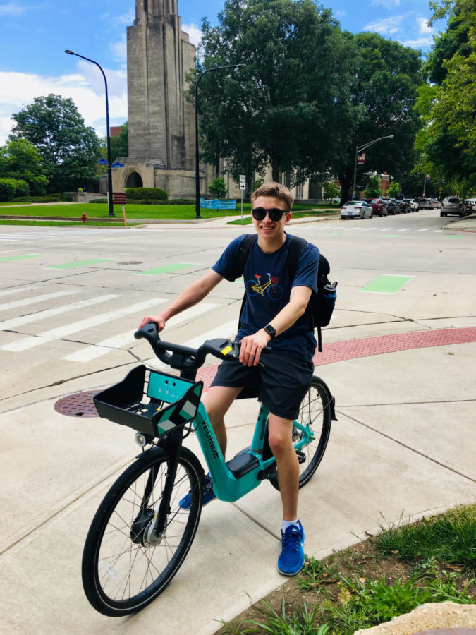 Picture of Erik Johnson standing on a bike outside