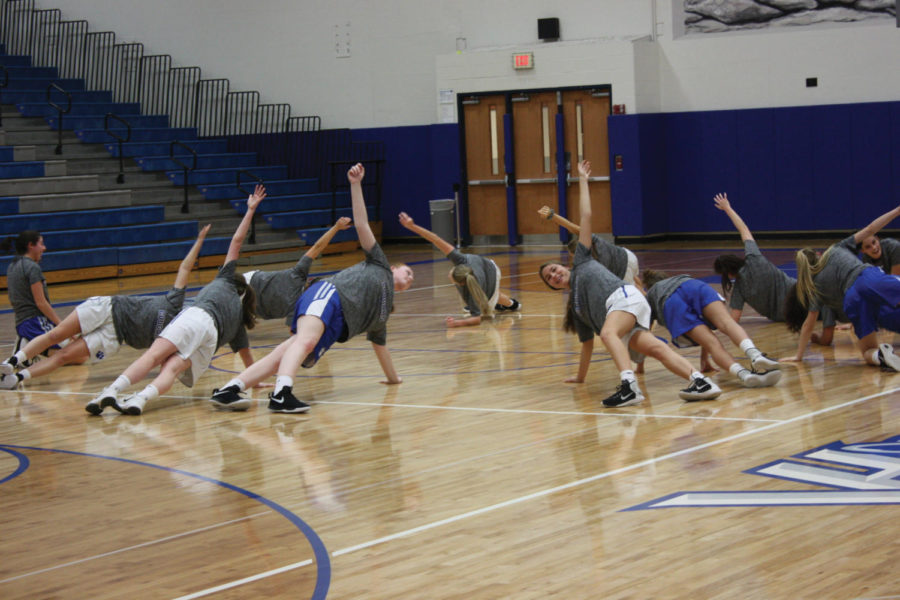 Members of the girls' basketball team are shown during warmups inside the main VHHS gym.