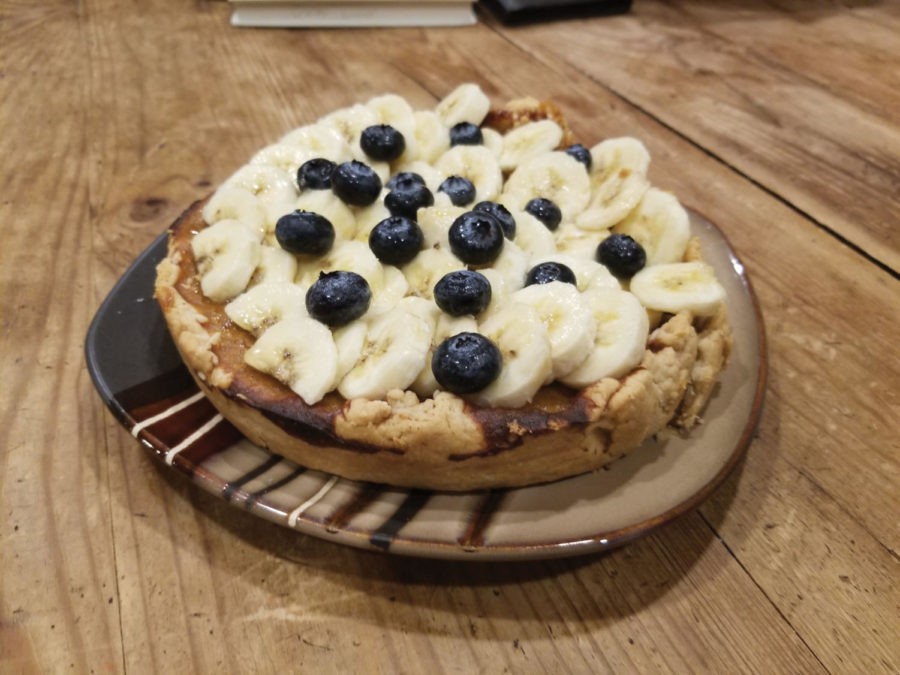 The+pumpkin+pie+on+a+plate+with+bananas+and+blueberries+on+top.