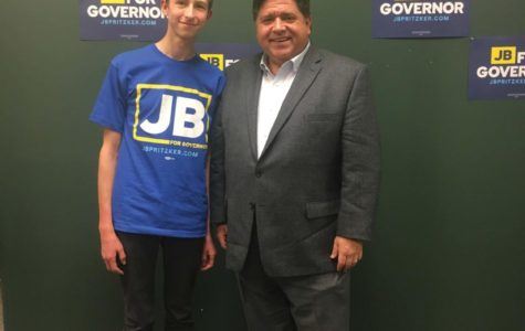 A VHHS student stands next to the Illinois Governor J.B Pritzker