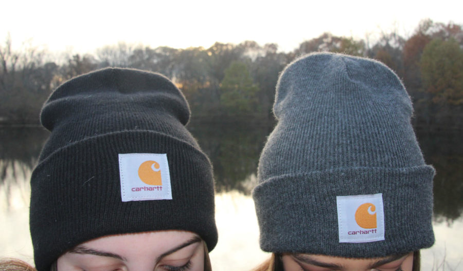 A+close+up+shot+of+two+girls+wearing+Carhartt+beanies.+The+one+on+the+left+is+a+black+beanie+and+the+one+on+the+right+is+a+grey+beanie.