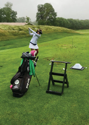 Lexi Schulman (9) holds her club in preparation to swing it