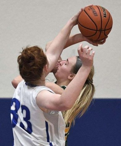 Grace Koepke goes up for an intense block.