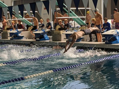 Jacob Schifrin explodes off his starting block into the water.