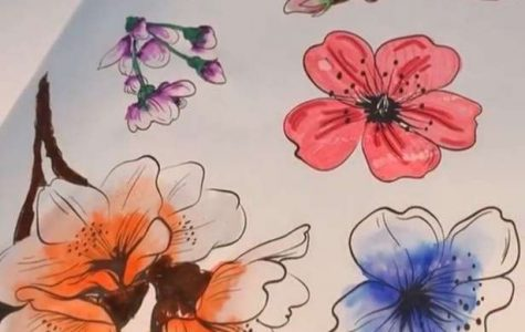 Water color flowers painted in a notebook.