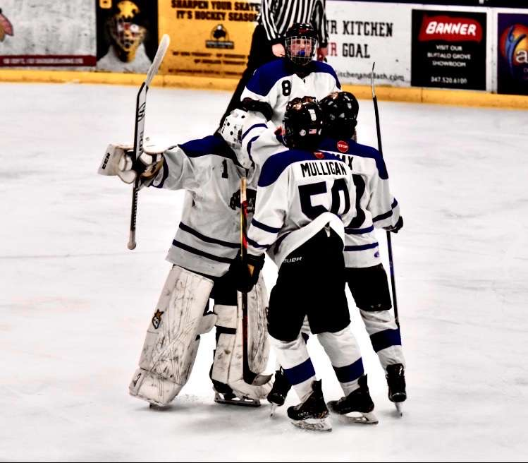 Libertyville+senior+Chris+Mulligan+and+his+teammates+talk+on+the+ice+at+an+Ice+Cats+game.