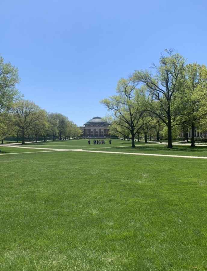 Few people stand on an empty UIUC quad in April 2020.