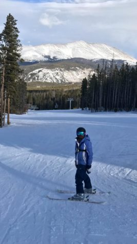 Student skiing on the slopes.