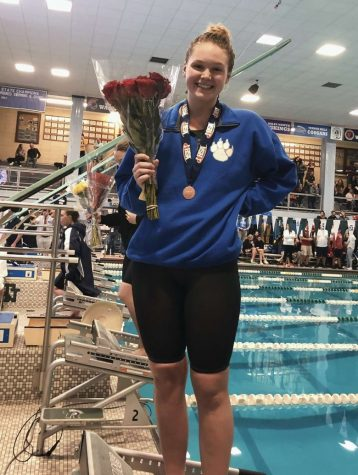 Pictured here is Casey Craffey holding roses after a swim competition.