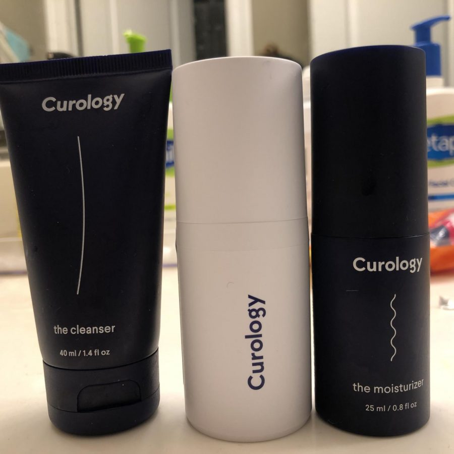 Three bottles of Curology. One bottle is white, while the others are black.