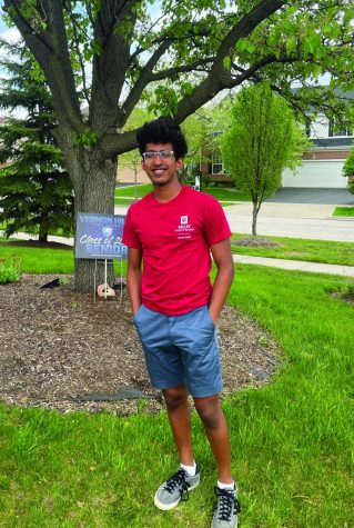 Abhishek stands outside and smiles in an Indiana University t-shirt.