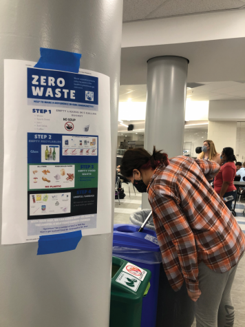 Rabiga Abdulleva (12) contributes her National Honor Society service hours by volunteering to sort waste into the appropriate bins during her lunch period.